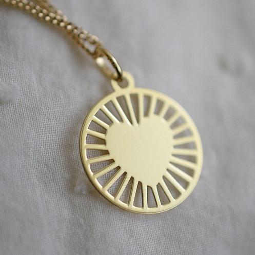 Médaille coeur rayonnant