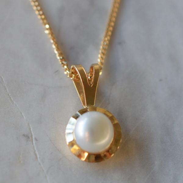 Pendentif perle couronnée or jaune 18cts